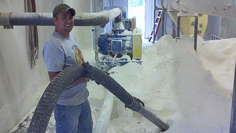 Mitchel Enterprises Ops Manager operates vacuum truck to clean up flour spill.